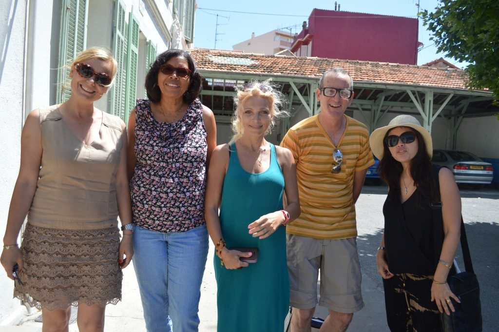 A group of adult students studying French in Cannes