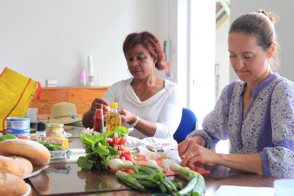 Women cooking in french summer courses in a host family