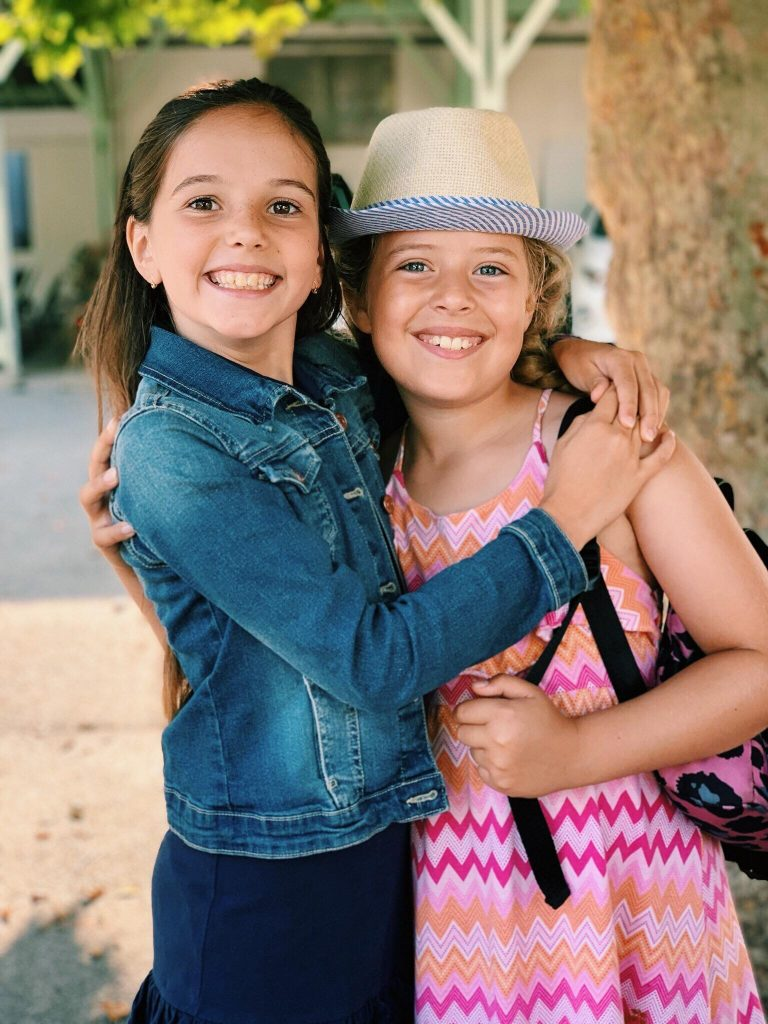 Two happy children in french summer course