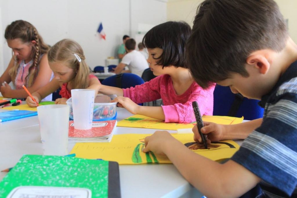 A group of kids learning French in a summer programme in the south of France