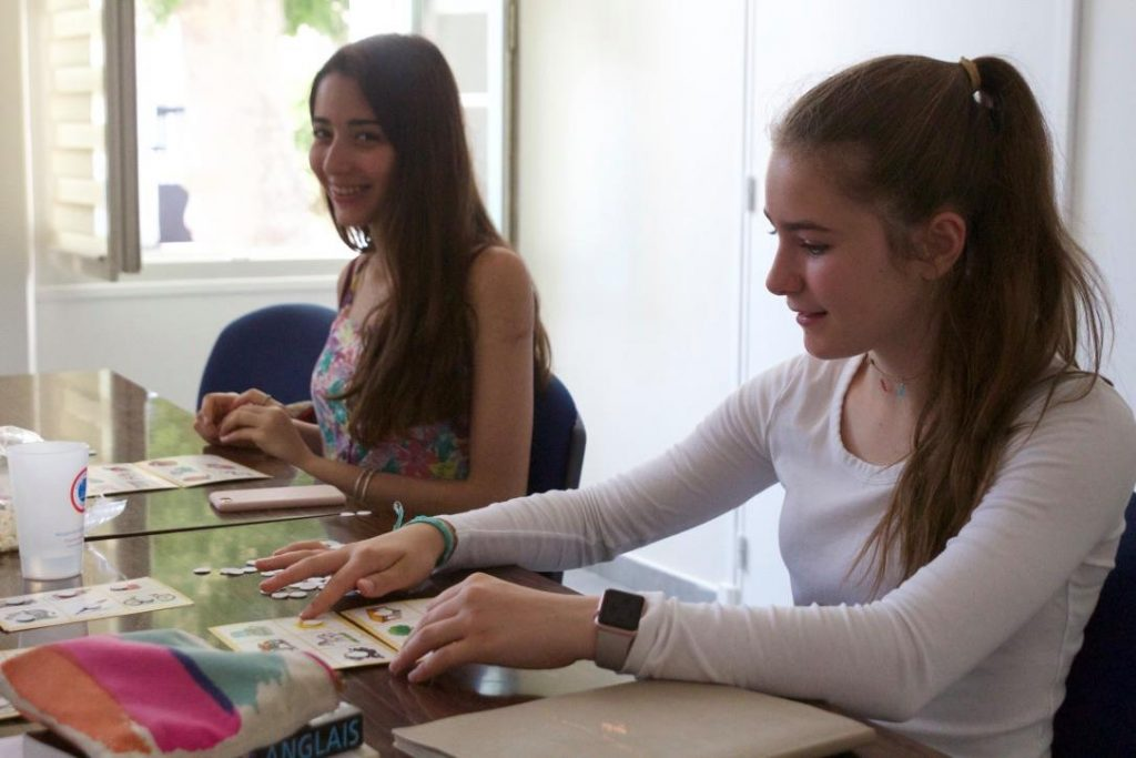 Two teenagers learning French with family French summer courses