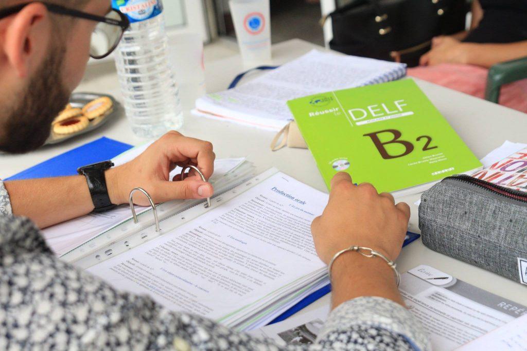 A student prepares DELF B2 French exam