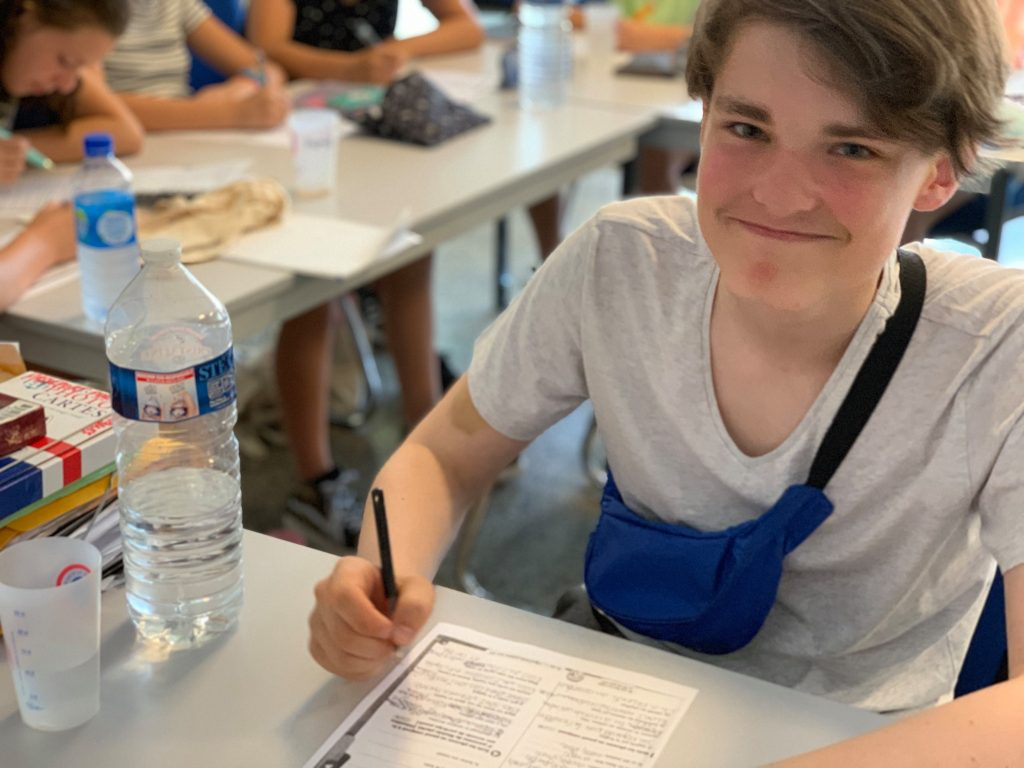 Teenager student in class at French summer school in Cannes