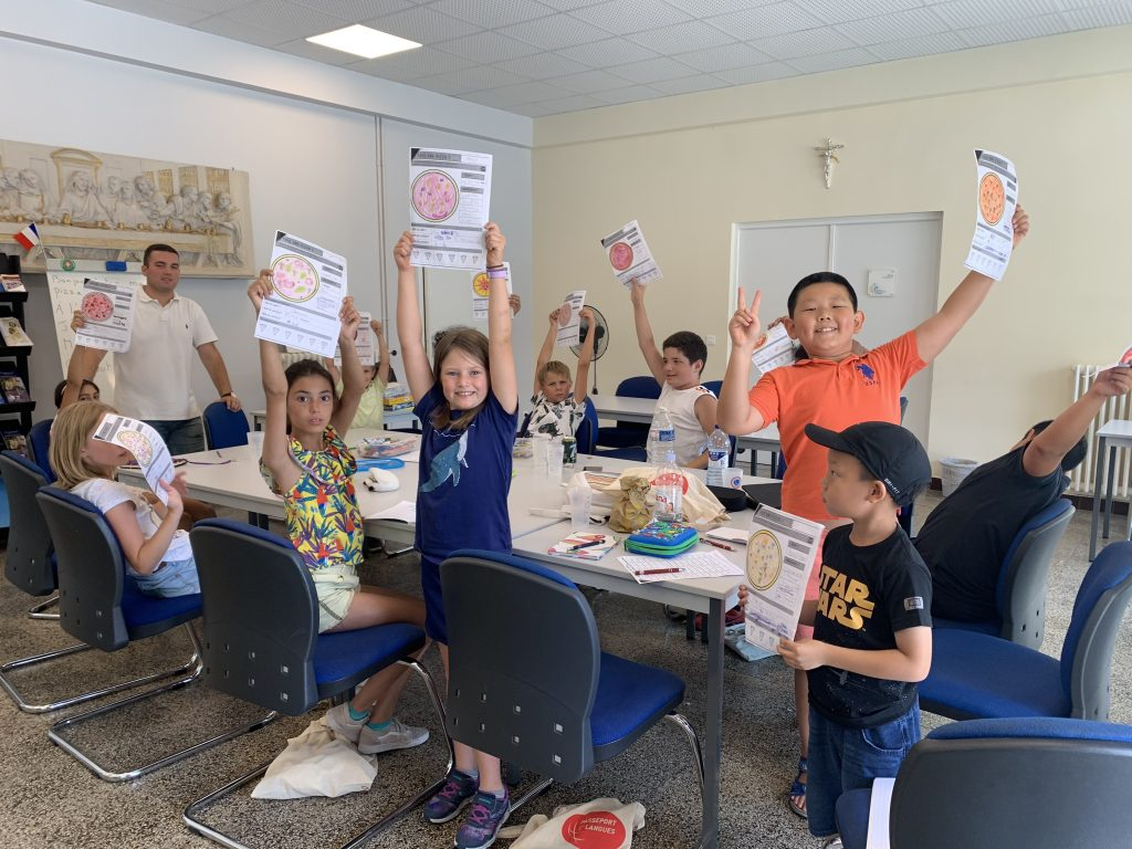 Joyful group of children learning French in Cannes