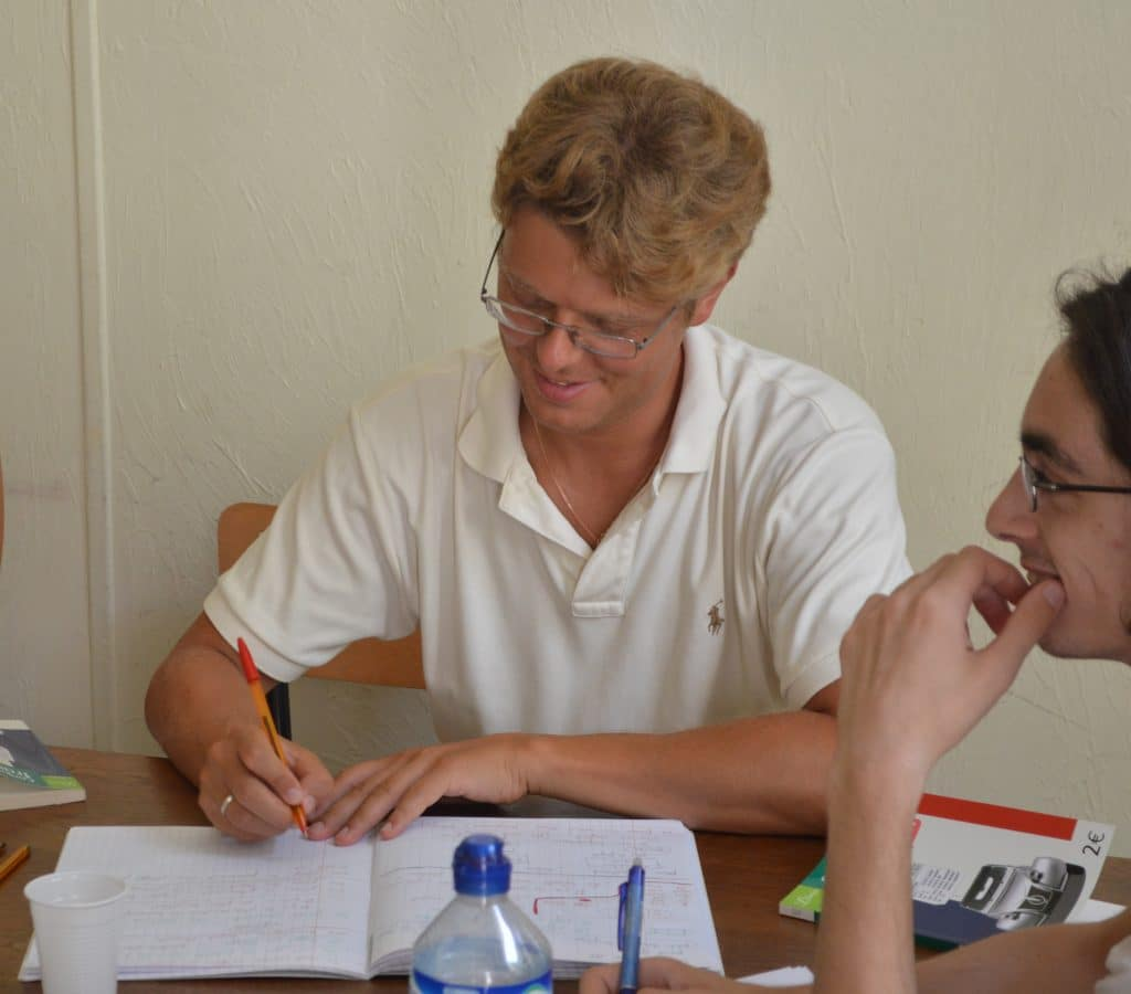 Adult student participing in an advanced French course